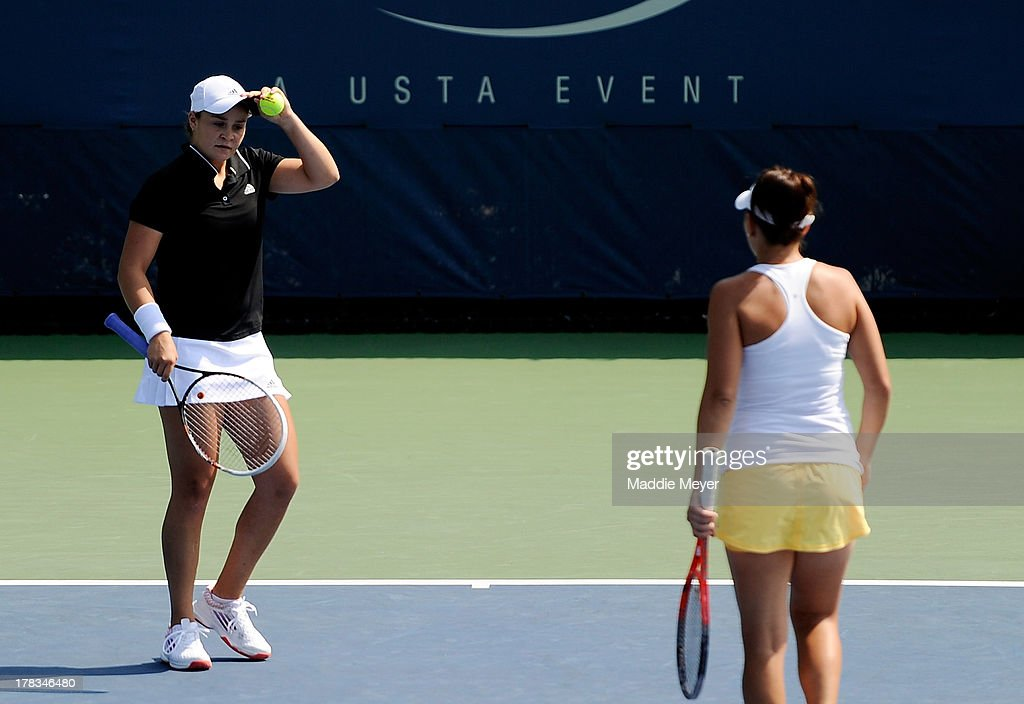 <a gi-track='captionPersonalityLinkClicked' href=/galleries/search?phrase=Casey+Dellacqua&family=editorial&specificpeople=575797 ng-click='$event.stopPropagation()'>Casey Dellacqua</a> of Australia and <a gi-track='captionPersonalityLinkClicked' href=/galleries/search?phrase=Ashleigh+Barty&family=editorial&specificpeople=7369424 ng-click='$event.stopPropagation()'>Ashleigh Barty</a> of Australia react during their women's doubles first round match against Sorana Cirstea of Romania and Yanina Wickmayer of Belgium on Day Four of the 2013 US Open at USTA Billie Jean King National Tennis Center on August 29, 2013 in the Flushing neighborhood of the Queens borough of New York City.