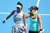 Casey Dellacqua of Australia and Kimiko DateKrumm of Japan in action in their second round doubles match against Silvia SolerEspinosa of Spain and...