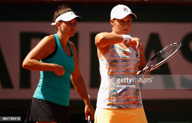 Casey Dellacqua of Australia and partner Ashleigh Barty of Australia speak during the ladies doubles final match against Bethanie MattekSands of The...