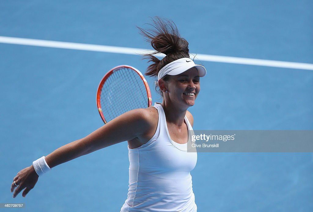 <a gi-track='captionPersonalityLinkClicked' href=/galleries/search?phrase=Casey+Dellacqua&family=editorial&specificpeople=575797 ng-click='$event.stopPropagation()'>Casey Dellacqua</a> of Australia celebrates winning her second round match against Kirsten Flipkens of Belgium during day three of the 2014 Australian Open at Melbourne Park on January 15, 2014 in Melbourne, Australia.