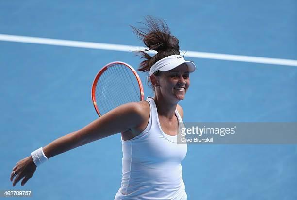 Casey Dellacqua of Australia celebrates winning her second round match against Kirsten Flipkens of Belgium during day three of the 2014 Australian...