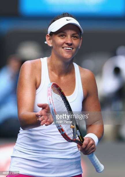 Casey Dellacqua of Australia celebrates winning her third round match against Jie Zheng of China during day five of the 2014 Australian Open at...
