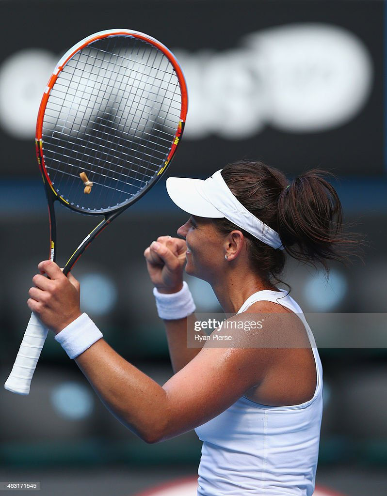 Casey Dellacqua of Australia celebrates winning match point in her third round match against Jie Zheng of China during day five of the 2014 Australian Open at Melbourne Park on January 17, 2014 in Melbourne, Australia.