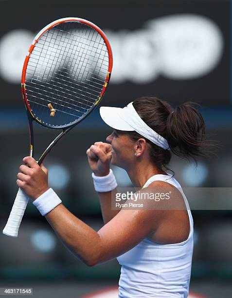 Casey Dellacqua of Australia celebrates winning match point in her third round match against Jie Zheng of China during day five of the 2014...