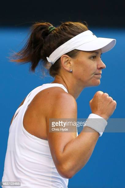 Casey Dellacqua of Australia celebrates winning the first set in her fourth round singles match against Eugenie Bouchard of Canada during day seven...