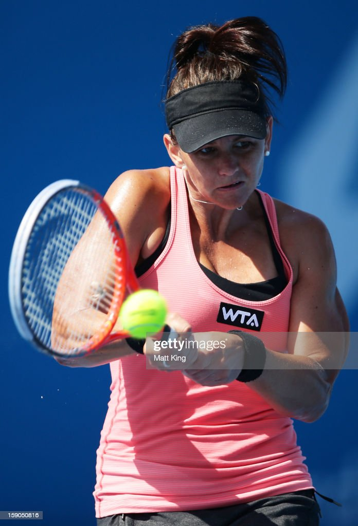 Casey Dellacqua of Australia plays a backhand in her first round match against Kimiko Date-Krumm of Japan during day two of the Sydney International at Sydney Olympic Park Tennis Centre on January 7, 2013 in Sydney, Australia.