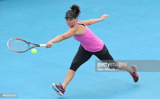 Casey Dellacqua of Australia plays a backhand in her first round match against Alison Van Uytvanck of Belgium during day two of the Moorilla Hobart...
