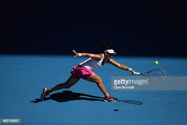 Casey Dellacqua of Australia plays a backhand in her third round match against Jie Zheng of China during day five of the 2014 Australian Open at...