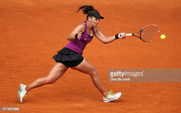 Casey Dellacqua of Australia plays a forehand against Francesca Schiavone of Italy in their first round match during day one of the Mutua Madrid Open...