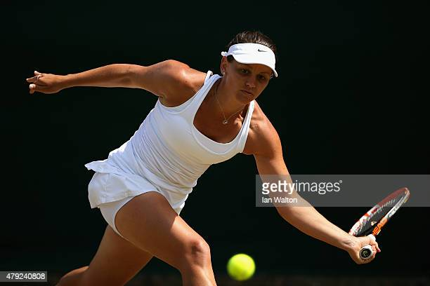 Casey Dellacqua of Australia plays a forehand during her match against Elina Svitolina of Ukraine in her Women's Singles Second Round match during...