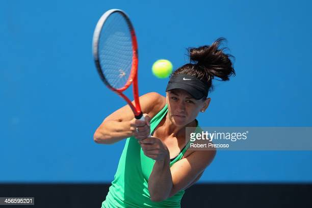 Casey Dellacqua of Australia plays a forehand in her Final round match against Arina Rodionova of Australia in the Australian Open 2014 Qualifying at...