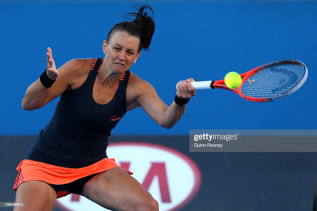 Casey Dellacqua of Australia plays a forehand in her first round match against Madison Keys of the United States during day one of the 2013 Australian Open at Melbourne Park on January 14, 2013 in Melbourne, Australia.