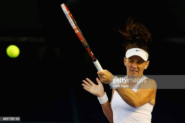 Casey Dellacqua of Australia plays a forehand in her fourth round singles match against Eugenie Bouchard of Canada during day seven of the 2014...