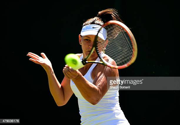 Casey Dellacqua of Australia plays a forehand in her Ladies Singles first round match against Tamira Paszek of Austria during day two of the...