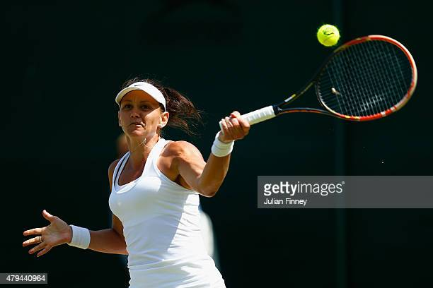 Casey Dellacqua of Australia plays a forehand in her Ladies' Singles Third Round match against Agnieszka Radwanska of Poland during day six of the...