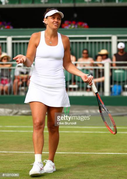 Casey Dellacqua of Australia reacts during the Mixed Doubles first round match against ChiaJung Chuan of Taipei and Misaki Doi of Japan on day five...