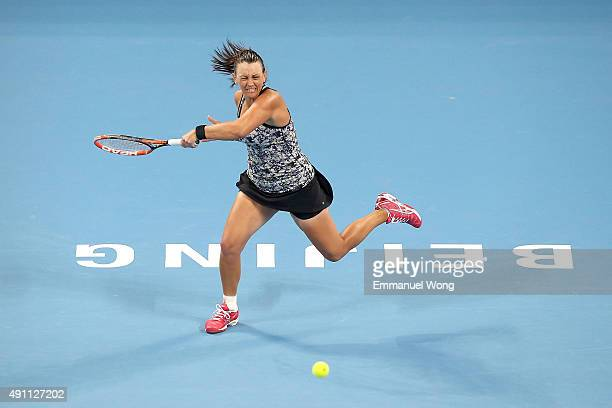 Casey Dellacqua of Australia returns a ball against Ana Ivanovic of Serbia during the day one of the 2015 China Open at the China National Tennis...