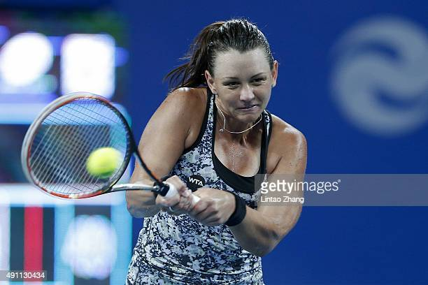 Casey Dellacqua of Australia returns a shot against Ana Ivanovic of Serbia during the day one of the 2015 China Open at the China National Tennis...
