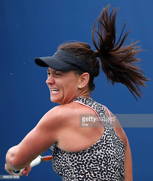 Casey Dellacqua of Australia returns a shot against Anett Kontaveit of Estonia during her Women's Singles First Round match during Day One of the...