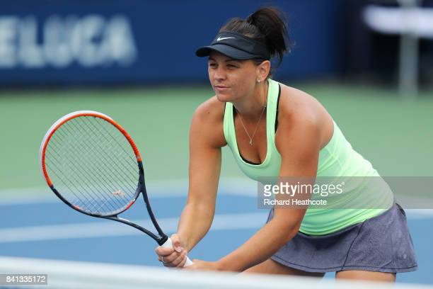 Casey Dellacqua of Australia returns a shot against Natela Dzalamidze and Veronika Kudermetova of Russia during their first round Women's Doubles...
