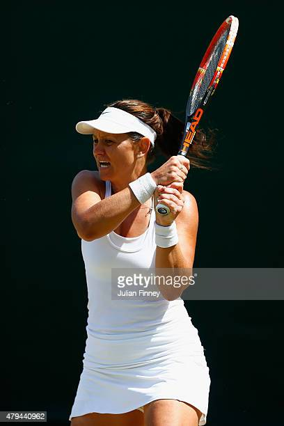 Casey Dellacqua of Australia returns a shot in her Ladies' Singles Third Round match against Agnieszka Radwanska of Poland during day six of the...