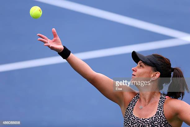 Casey Dellacqua of Australia serves against Anett Kontaveit of Estonia during her Women's Singles First Round match during Day One of the 2015 US...