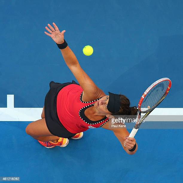 Casey Dellacqua of Australia serves in her singles match against Heather Watson of Great Britain during day six of the 2015 Hopman Cup at Perth Arena...