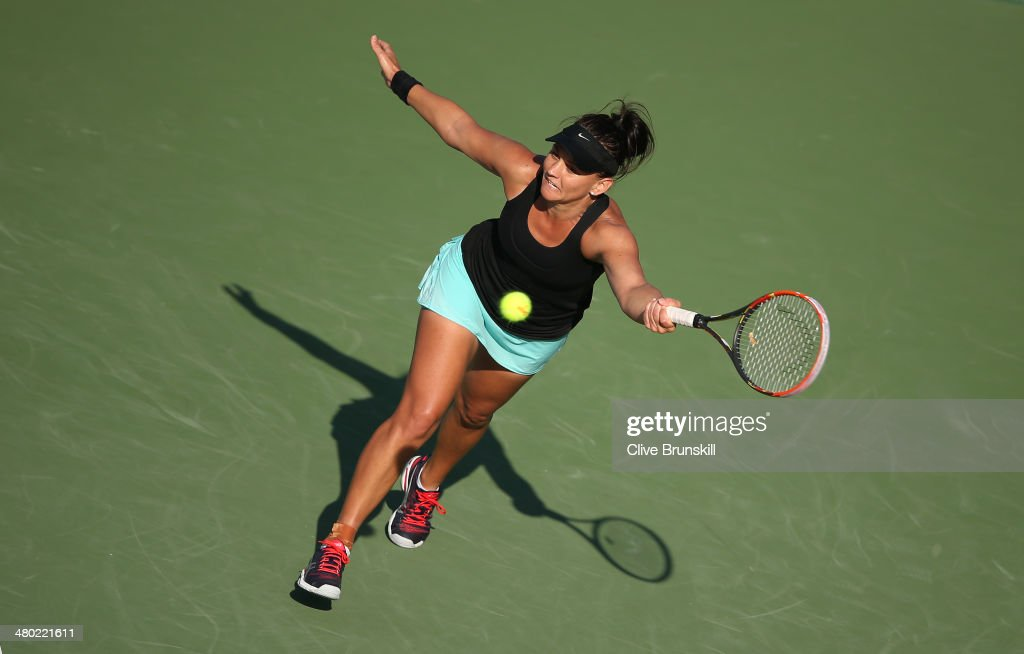 <a gi-track='captionPersonalityLinkClicked' href=/galleries/search?phrase=Casey+Dellacqua&family=editorial&specificpeople=575797 ng-click='$event.stopPropagation()'>Casey Dellacqua</a> of Australia stretches to play a forehand against Venus Williams of the United States during their third round match during day 7 at the Sony Open at Crandon Park Tennis Center on March 23, 2014 in Key Biscayne, Florida.