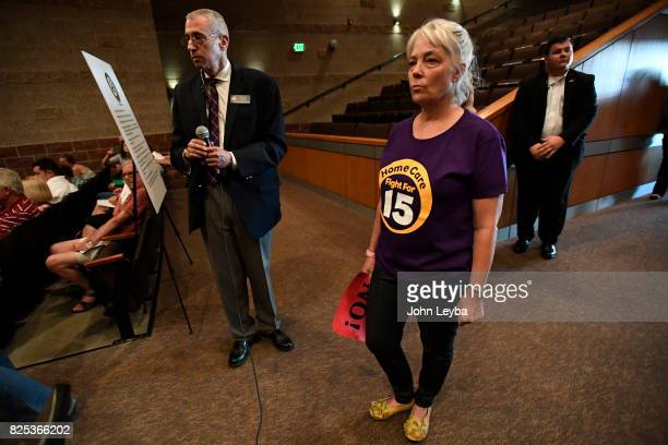 Casey DiGaetano of Aurora waits to as a question during US Rep Mike Coffman's town hall at Prairie View High School in on August 1 2017 Henderson
