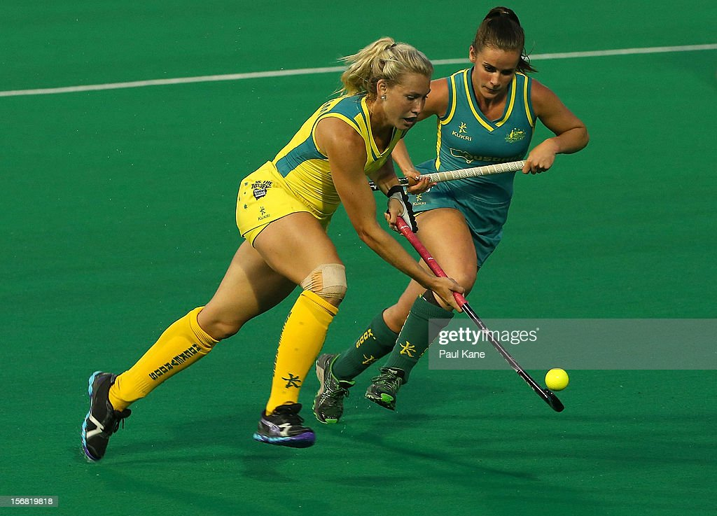 Casey Eastham of the Hockeyroos and Amelia Spence of the Jillaroos contest for the ball against during the womens Australia v Australia under 21 game on day one of the 2012 International Super Series at Perth Hockey Stadium on November 22, 2012 in Perth, Australia.