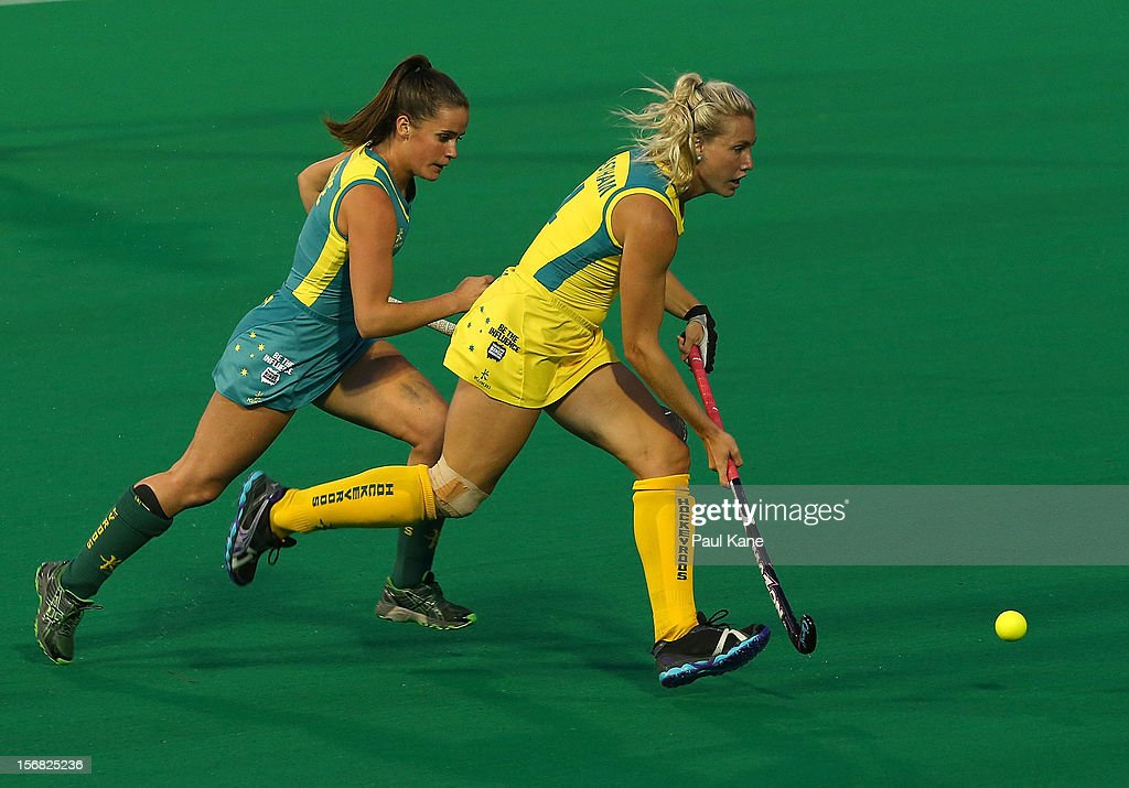 <a gi-track='captionPersonalityLinkClicked' href=/galleries/search?phrase=Casey+Eastham&family=editorial&specificpeople=4891862 ng-click='$event.stopPropagation()'>Casey Eastham</a> of the Hockeyroos and Amelia Spence of the Jillaroos contest for the ball against during the womens Australia v Australia under 21 game on day one of the 2012 International Super Series at Perth Hockey Stadium on November 22, 2012 in Perth, Australia.