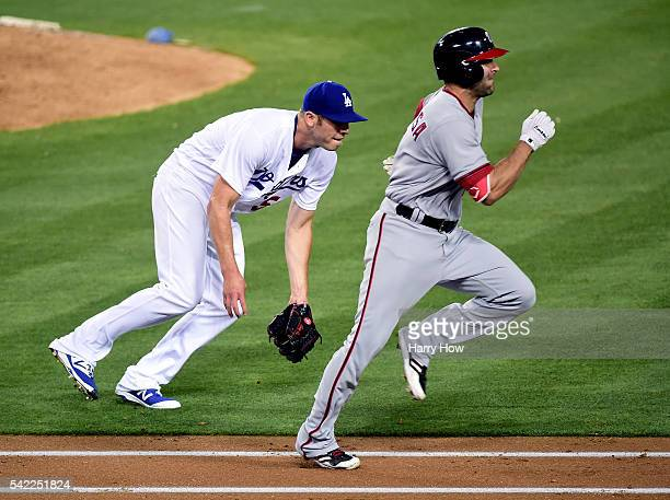 Casey Fien of the Los Angeles Dodgers makes a play to first on a bunt from Danny Espinosa of the Washington Nationals during the seventh inning at...