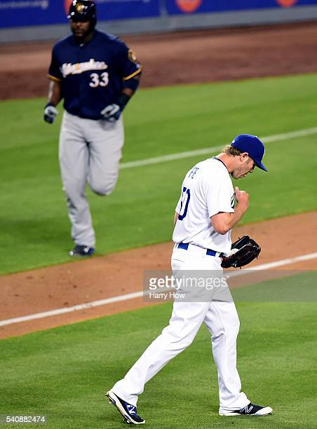 Casey Fien of the Los Angeles Dodgers reacts to a two run homerun from Chris Carter of the Milwaukee Brewers to trail 63 during the fifth inning at...