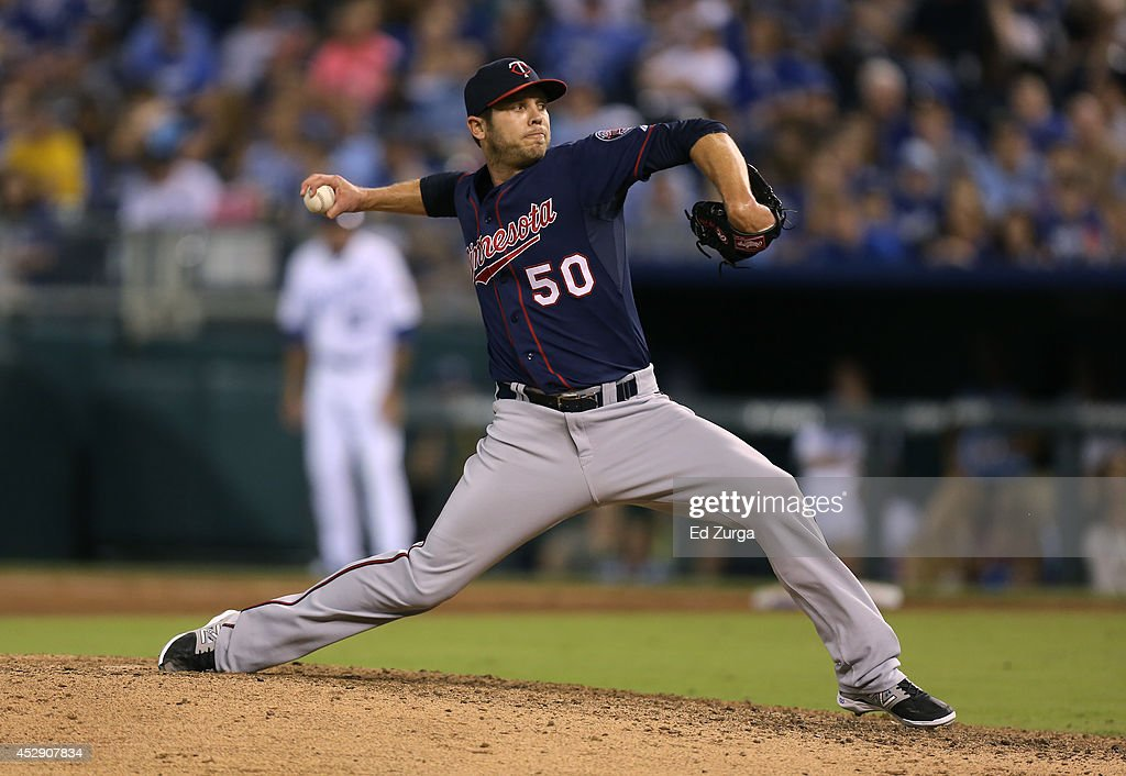 Casey Fien #50 of the Minnesota Twins throws in the eighth inning against the Kansas City Royals at Kauffman Stadium on July 29, 2014 in Kansas City, Missouri.
