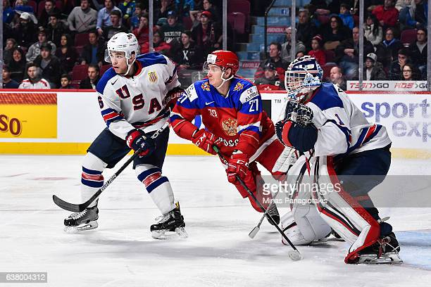 Casey Fitzgerald of Team United States and Denis Guryanov of Team Russia battle for position in front of goaltender Tyler Parsons during the 2017...