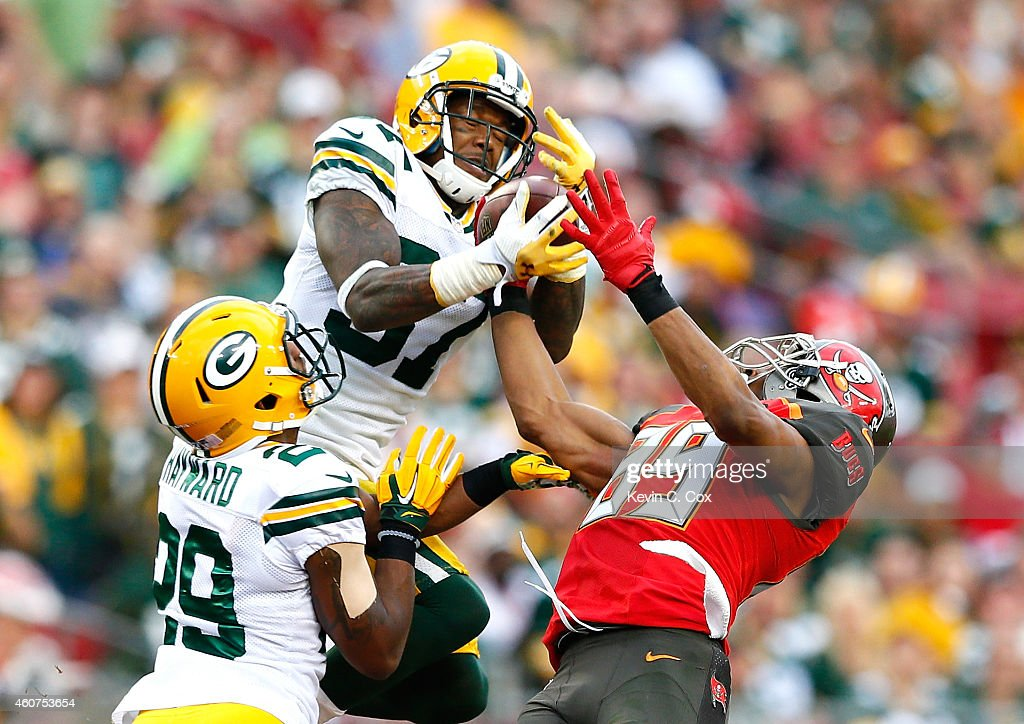 Casey Hayward #29 defends as Sam Shields #37 of the Green Bay Packers fails to intercept this pass intended for Russell Shepard #89 of the Tampa Bay Buccaneers at Raymond James Stadium on December 21, 2014 in Tampa, Florida.