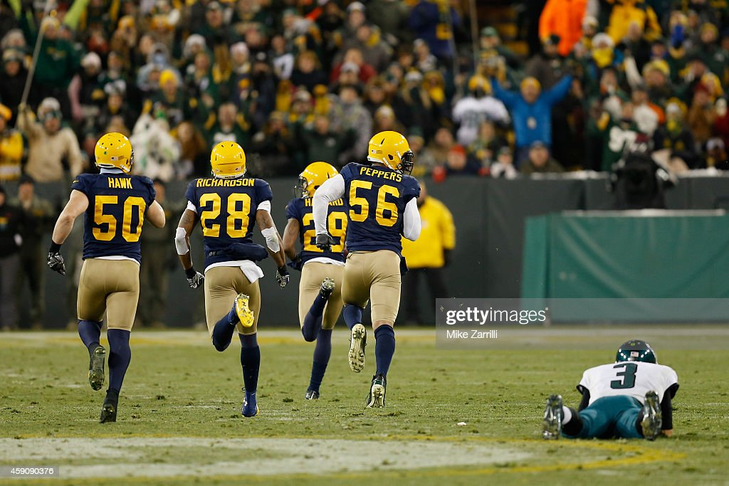Casey Hayward of the Green Bay Packers runs a fumble by quarterback Mark Sanchez of the Philadelphia Eagles for a touchdown during the fourth quarter...