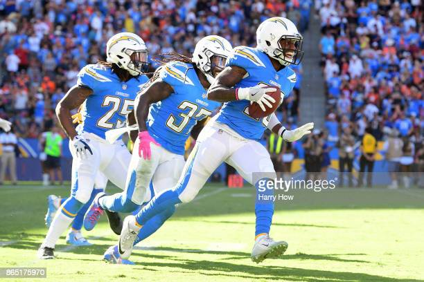 Casey Hayward of the Los Angeles Chargers celebrates the interception in the fourth quarter during the game against the Denver Broncos at the StubHub...