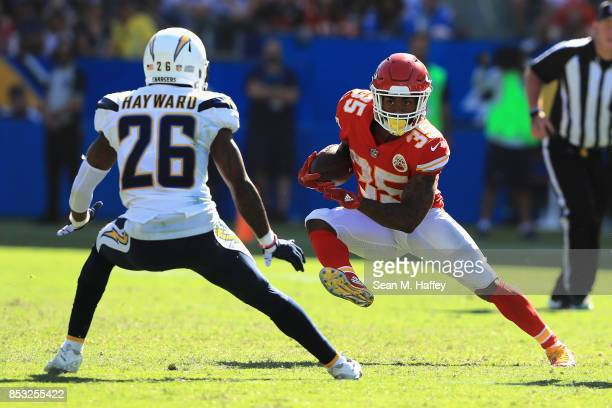 Casey Hayward of the Los Angeles Chargers defends against the run of Charcandrick West of the Kansas City Chiefs during the second half of a game at...
