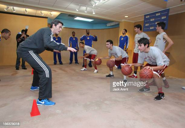 Casey Hill assistant coach of the Santa Cruz Warriors directs local youth basketball players through a drill during the clubs first ever community...