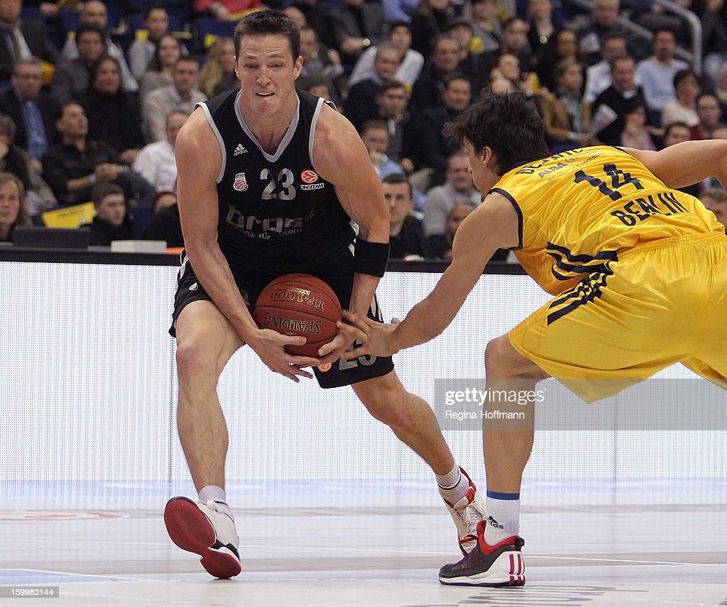 <a gi-track='captionPersonalityLinkClicked' href=/galleries/search?phrase=Casey+Jacobsen&family=editorial&specificpeople=201618 ng-click='$event.stopPropagation()'>Casey Jacobsen</a>, #23 of Brose Baskets Bamberg competes with Nihad Djedovic, #14 of Alba Berlin during the 2012-2013 Turkish Airlines Euroleague Top 16 Date 5 between Alba Berlin v Brose Baskets Bamberg at O2 World on January 24, 2013 in Berlin, Germany.