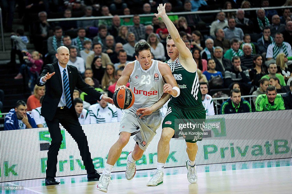 <a gi-track='captionPersonalityLinkClicked' href=/galleries/search?phrase=Casey+Jacobsen&family=editorial&specificpeople=201618 ng-click='$event.stopPropagation()'>Casey Jacobsen</a>, #23 of Brose Baskets Bamberg competes with Vytenis Lipkevicius, #10 of Zalgiris Kaunas during the 2013-2014 Turkish Airlines Euroleague Regular Season Date 5 game between Zalgiris Kaunas v Brose Baskets Bamberg at Zalgiris Arena on November 14, 2013 in Kaunas, Lithuania.