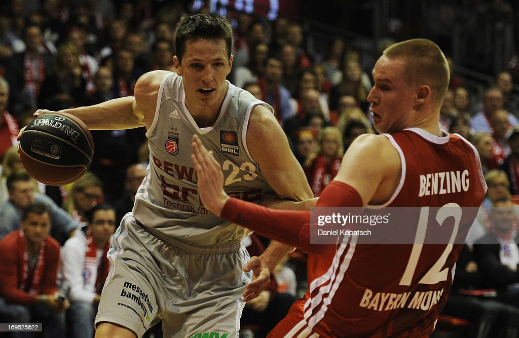 <a gi-track='captionPersonalityLinkClicked' href=/galleries/search?phrase=Casey+Jacobsen&family=editorial&specificpeople=201618 ng-click='$event.stopPropagation()'>Casey Jacobsen</a> of Bamberg (L) is challenged by Robin Benzing of Muenchen during the second Game of the semifinals of the Beko Basketball Playoffs match between FC Bayern Muenchen and Brose Baskets at Audi-Dome on May 26, 2013 in Munich, Germany.