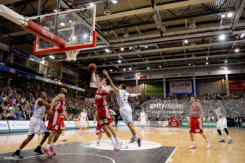 Casey Jacobsen of Brose Baskets takes the rebound under the pressure of Joshiko Saibou of Trier during the Beko BBL Basketball Bundesliga match between TBB Trier and Brose Baskets on February 17, 2013 in Trier, Germany.