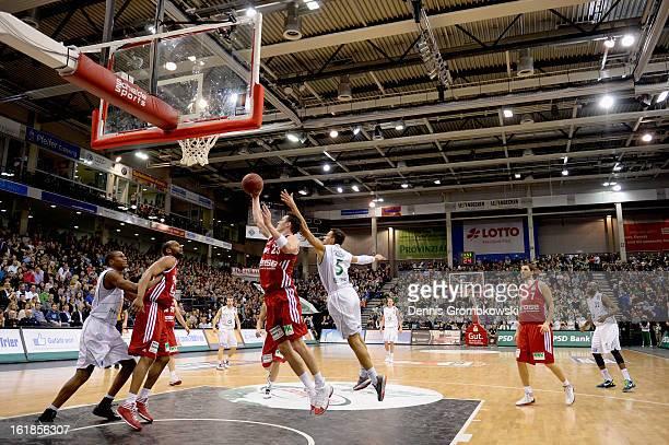 Casey Jacobsen of Brose Baskets takes the rebound under the pressure of Joshiko Saibou of Trier during the Beko BBL Basketball Bundesliga match...
