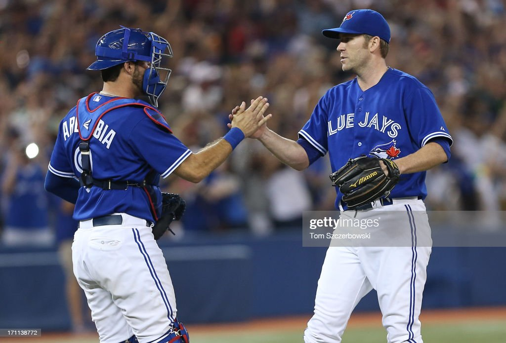 Casey Janssen #44 of the Toronto Blue Jays celebrates their tenth victory in a row with J.P. Arencibia #9 during MLB game action against the Baltimore Orioles on June 22, 2013 at Rogers Centre in Toronto, Ontario, Canada.