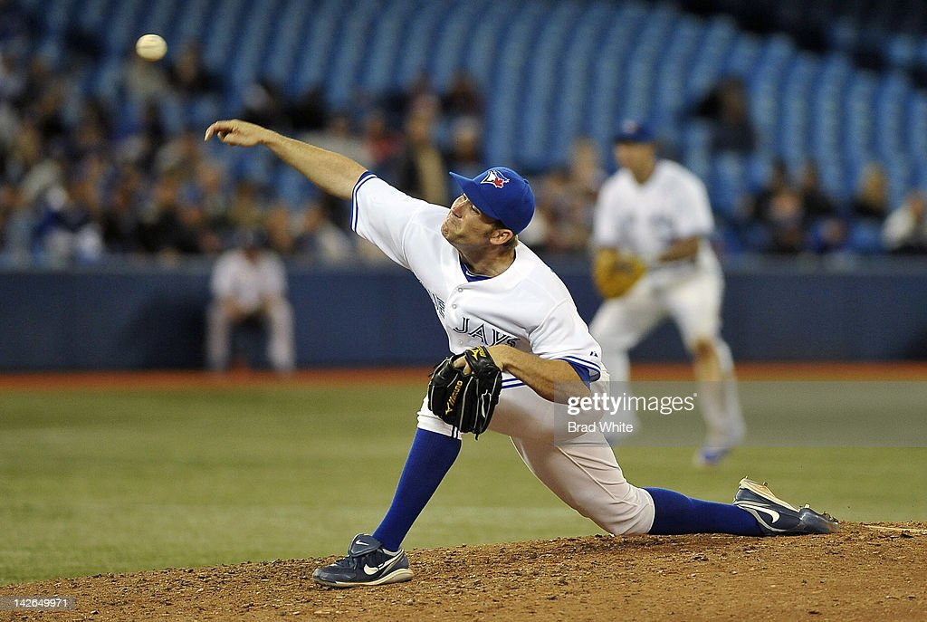 <a gi-track='captionPersonalityLinkClicked' href=/galleries/search?phrase=Casey+Janssen&family=editorial&specificpeople=598479 ng-click='$event.stopPropagation()'>Casey Janssen</a> #44 of the Toronto Blue Jays delivers a pitch during MLB game action against the Boston Red Sox April 10, 2012 at Rogers Centre in Toronto, Ontario, Canada.