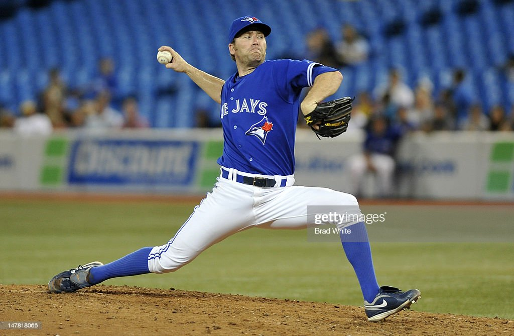 <a gi-track='captionPersonalityLinkClicked' href=/galleries/search?phrase=Casey+Janssen&family=editorial&specificpeople=598479 ng-click='$event.stopPropagation()'>Casey Janssen</a> #44 of the Toronto Blue Jays delivers a pitch during MLB game action against the Kansas City Royals July 3, 2012 at Rogers Centre in Toronto, Ontario, Canada.