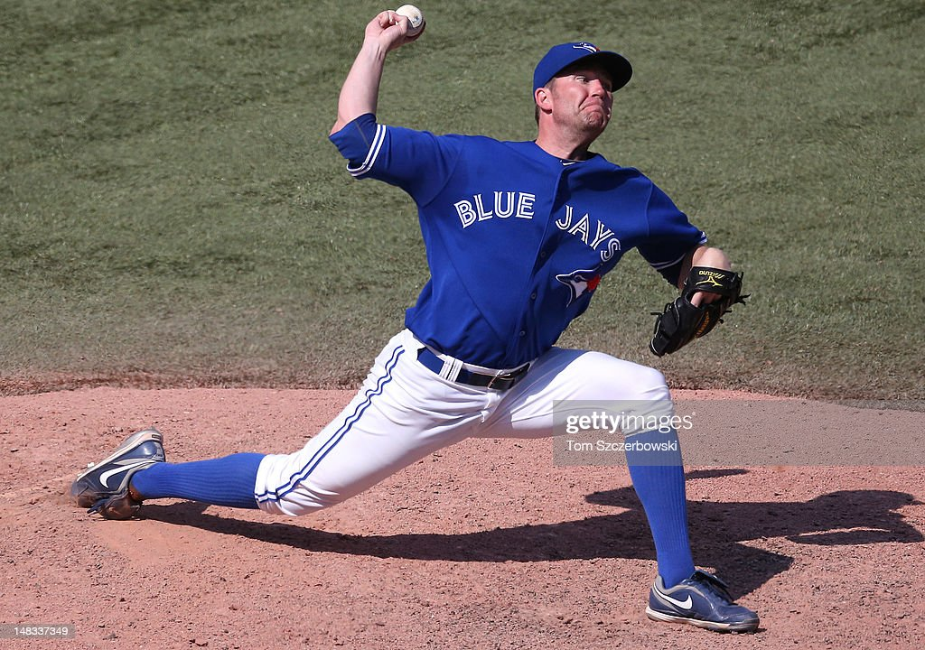 <a gi-track='captionPersonalityLinkClicked' href=/galleries/search?phrase=Casey+Janssen&family=editorial&specificpeople=598479 ng-click='$event.stopPropagation()'>Casey Janssen</a> #44 of the Toronto Blue Jays delivers a pitch during MLB game action against the Cleveland Indians on July 14, 2012 at Rogers Centre in Toronto, Ontario, Canada.