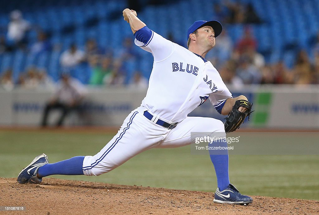 <a gi-track='captionPersonalityLinkClicked' href=/galleries/search?phrase=Casey+Janssen&family=editorial&specificpeople=598479 ng-click='$event.stopPropagation()'>Casey Janssen</a> #44 of the Toronto Blue Jays delivers a pitch during MLB game action against the Tampa Bay Rays on August 31, 2012 at Rogers Centre in Toronto, Ontario, Canada.